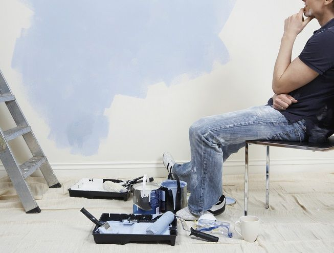 Man painting and thinking