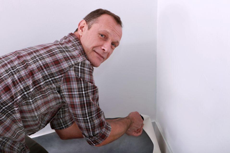 Man removing carpet