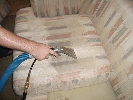 kleen rite technician cleaning couch