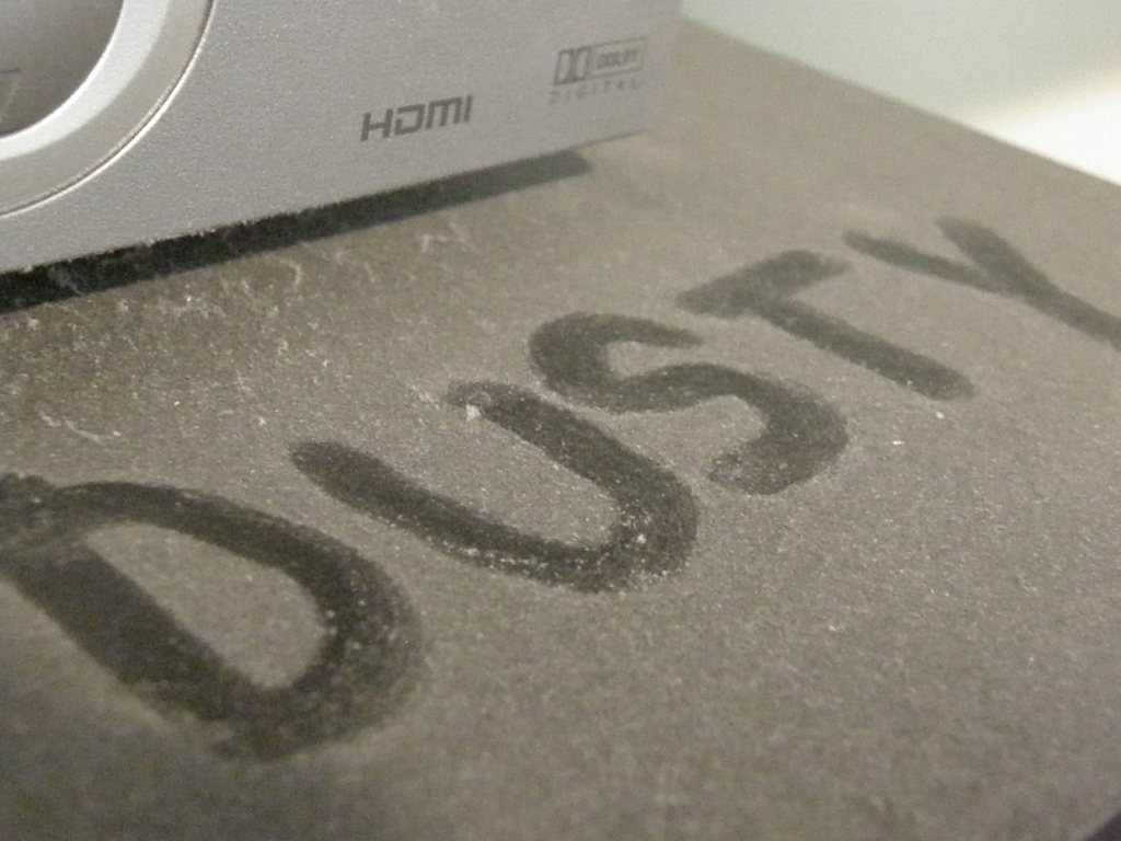 Dusty written in dust on table