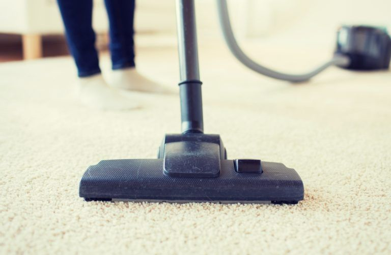 close up of vacuuming carpet
