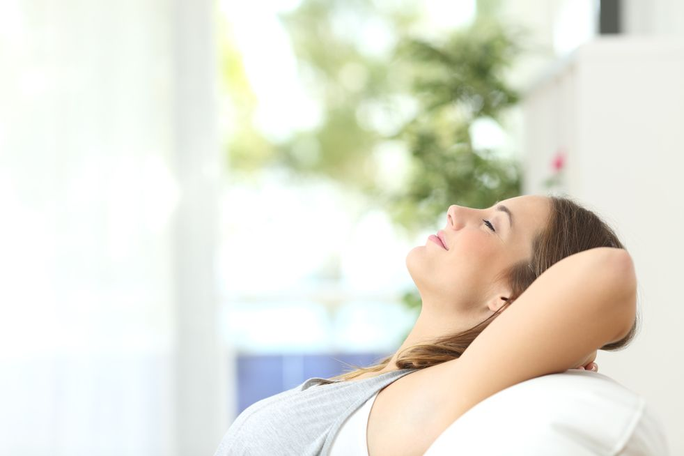 woman breathing easy on couch
